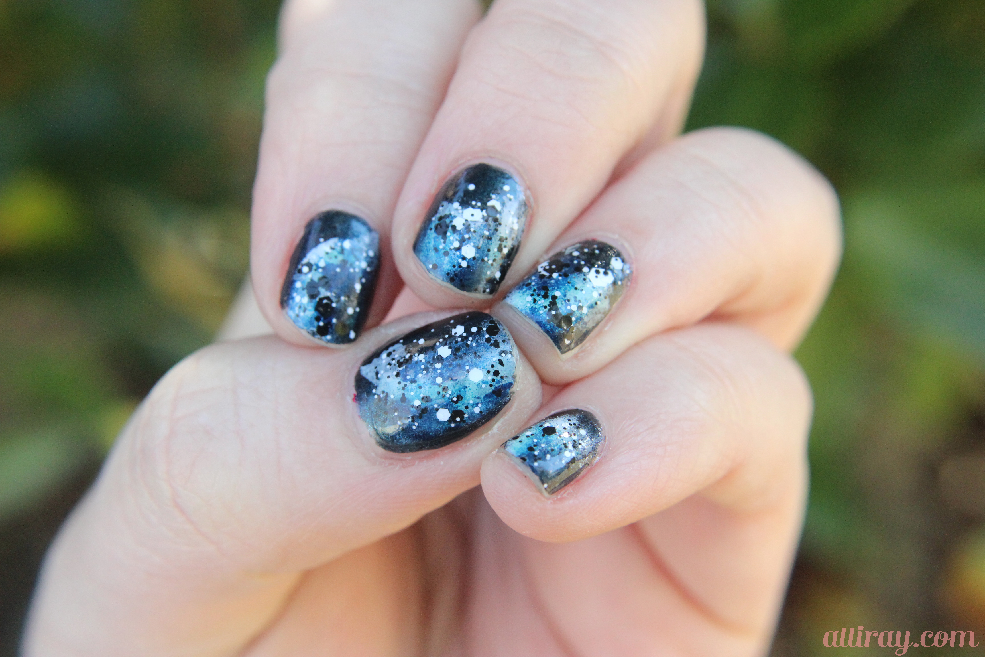 About us for Outer space nail design